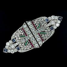 Art deco piece with synthetic rubies & sapphires.